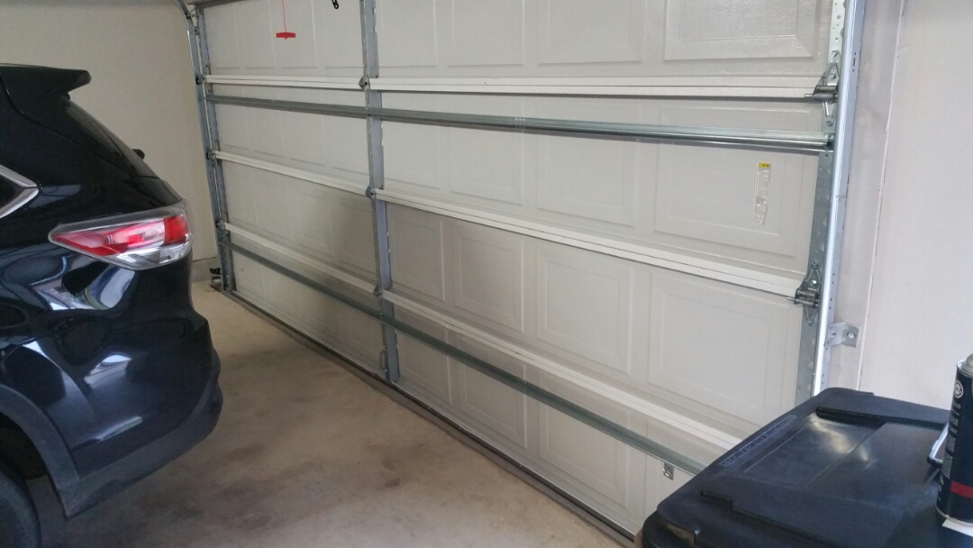 Dripping Springs, TX - Garage door service in dripping springs.  Garage door was struck and rollers came out of track.  We added several supports and straightened bottom section.