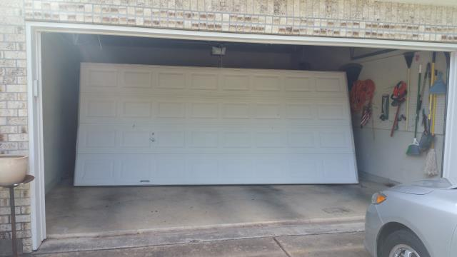 Round Rock, TX - Round Rock, Texas.  Replaced an 16 X 7  broken door. Installed a new  16 X 7 with a new lift master opener.