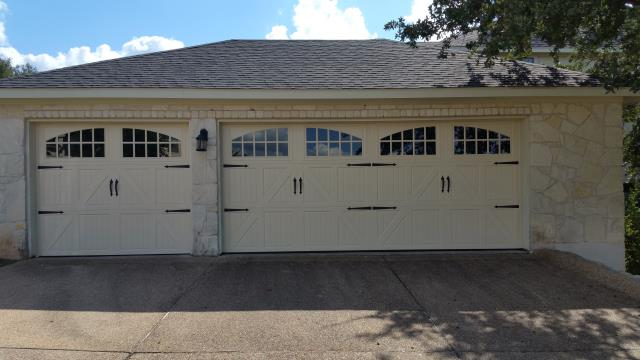 Lago Vista, TX - Installed a new 16 X 7 and a 8 X 7 garage door with windows and hardware in Lago Vista, Texas.