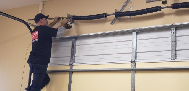 Pflugerville, TX - Replaced  broken springs with new torsion springs and rollers in Pflugerville, Tx.
