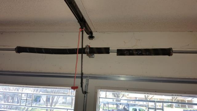 Pflugerville, TX - Pflugerville, Texas. Replaced broken garage door spring with both torsion springs, rollers and end bearing plates.