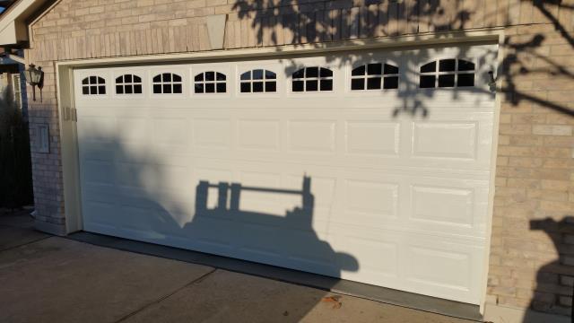 Austin, TX - Austin Texas. Replaced a 16 X & garage door with another 16 X 7 garage door with windows.