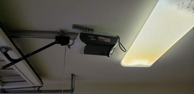 Austin, Texas. Replaced a Chamberlain garage door opener with a LIftmaster with WIFI, and rollers.
