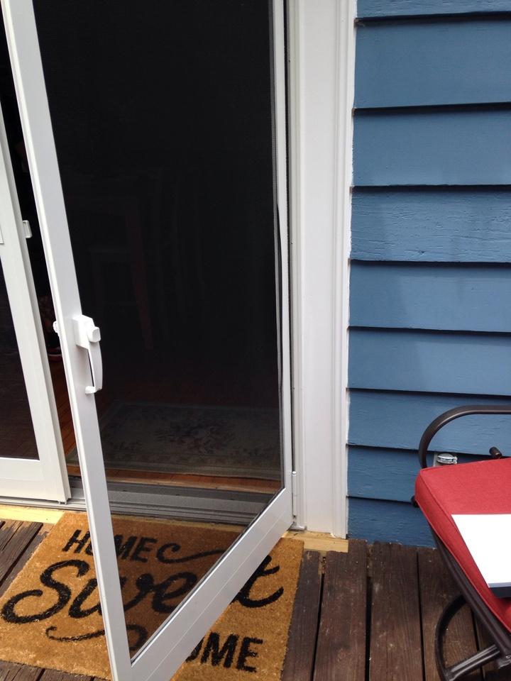 Worcester, MA - Renewal by Andersen Boston repairing screen door