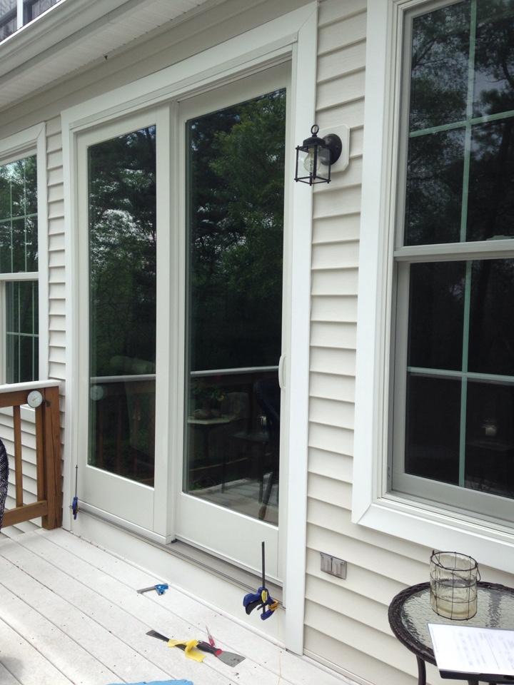 Plymouth, MA - Renewal by Andersen Boston inspecting patio door