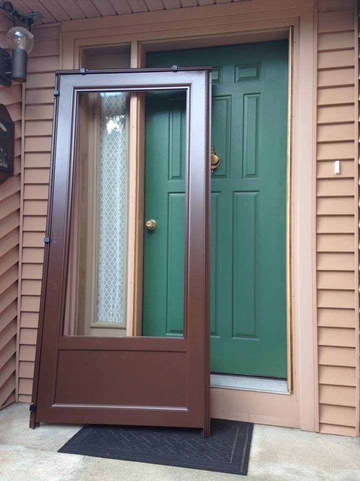 Worcester, MA - Renewal by Andersen Boston installing a storm door