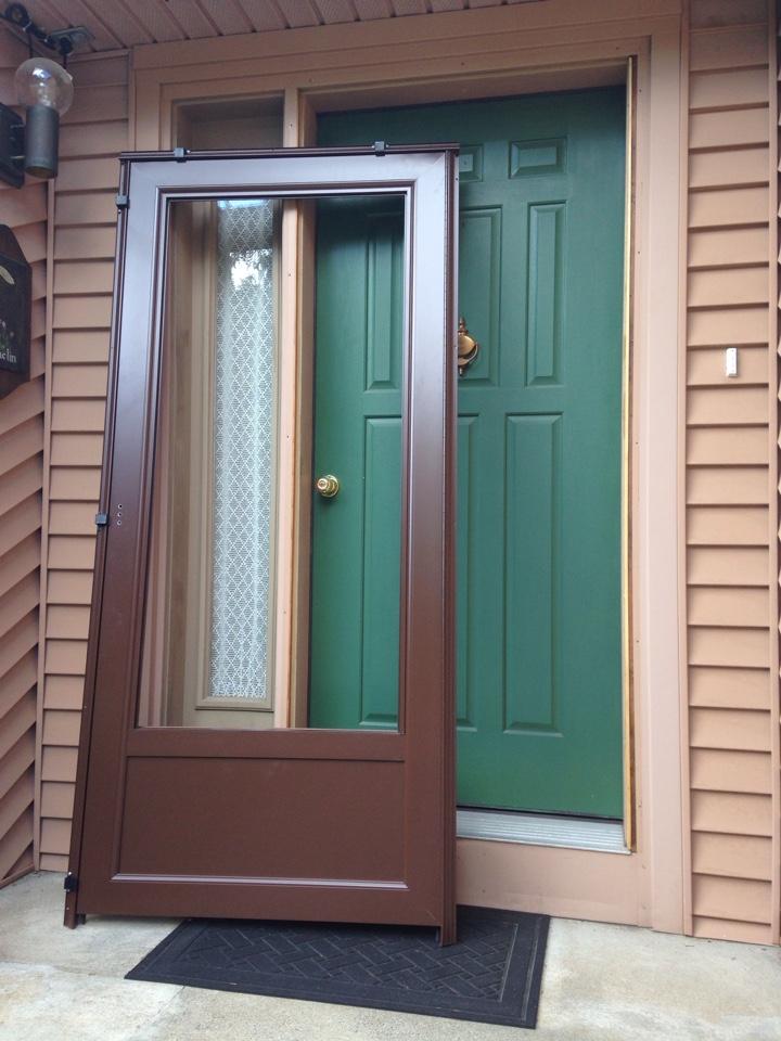 Worcester, MA - Renewal by Andersen Boston installing a storm door