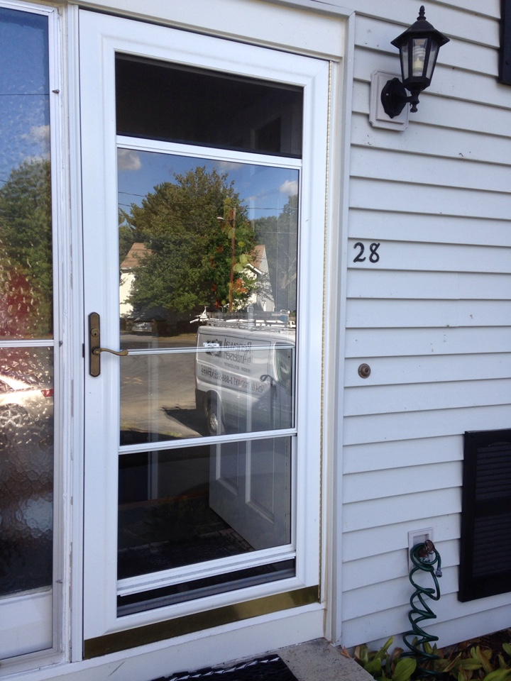 Framingham, MA - Renewal by Andersen Boston inspecting storm door