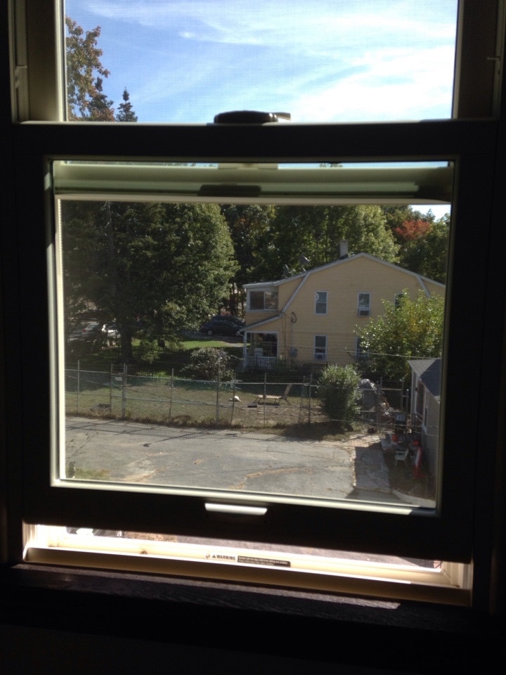 Shrewsbury, MA - Renewal by Andersen Boston inspecting double hung unit