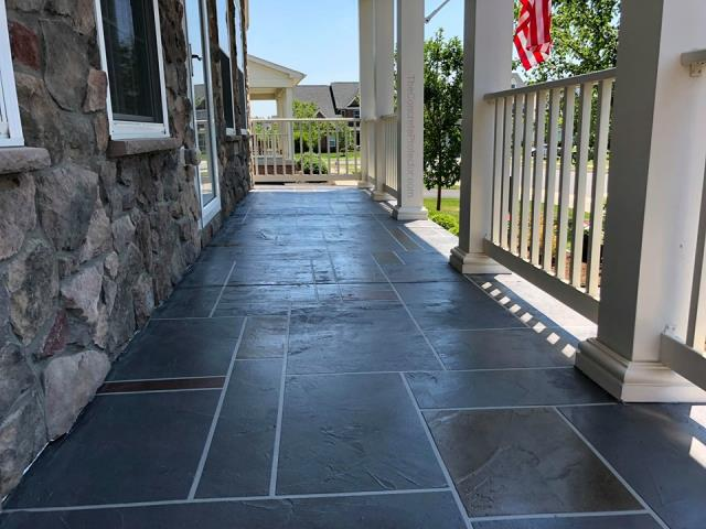 Tampa, FL - Want a decorative patio to enjoy your evenings outdoors? Stained Ashlar Slate creates a beautiful appeal to your home with protection to any weather you may encounter!!