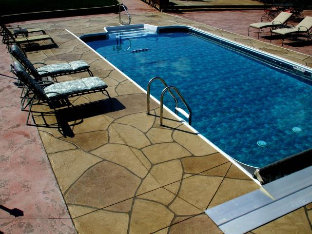 Winter Park, FL - Unique pool designs are what we create for you! Combine systems for a look like never before! Grand Flagstone and Stained Tuscan Slate are a perfect combination for your pool deck design!!! Do not need to brake the bank with these systems!!