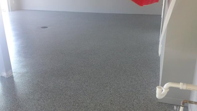 High Springs, FL - Revamp your garage floor today with Epoxy Flake!! Fix those concrete blemishes and cracks easily with our help! Any color you want we can create, even a floor to match your favorite sports team!!