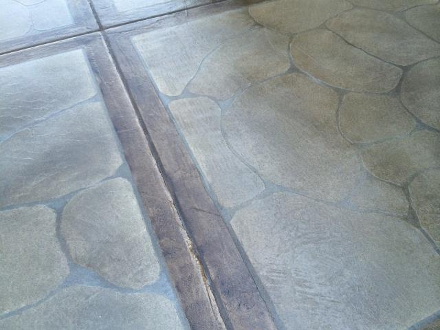 The Villages, FL - Thinking about revamping your driveway? Now is the perfect time! Grand Flagstone with a boarder creates a beautiful unique look for any driveway or garage combo! Authentic stone look at an affordable price!!