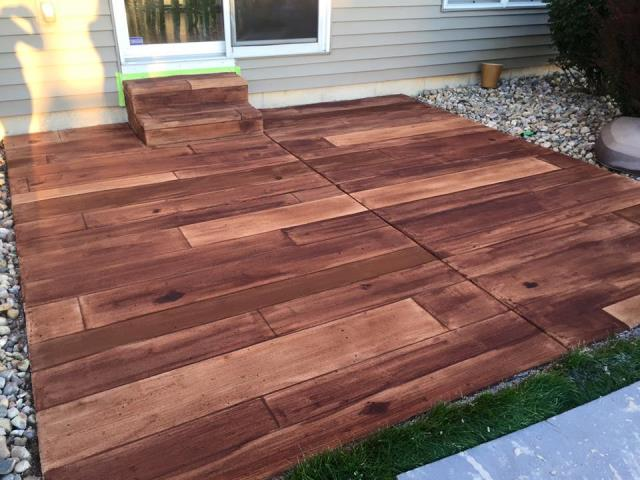 Orlando, FL - Does that grey, boring, ugly concrete surface you call a patio need a new look? Revamp and add excitement to any occasion with Rustic Wood!