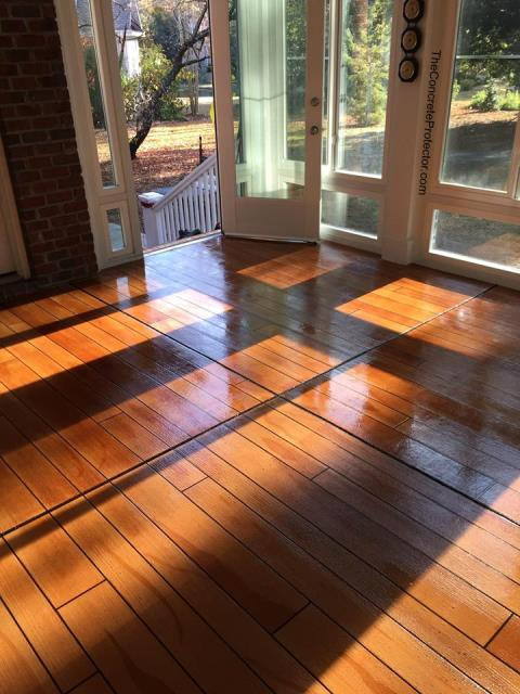 Apopka, FL - Relax and enjoy the scenery, rain or shine, every day in your sunroom with a new Rustic Wood floor!!!