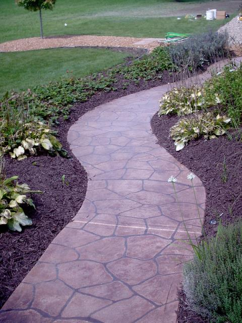 The Villages, FL - Get rid of the crackly old sidewalk and fall in love with the new Grand Flagstone surface! Give your home a new appeal without breaking the bank! Visit for more information!