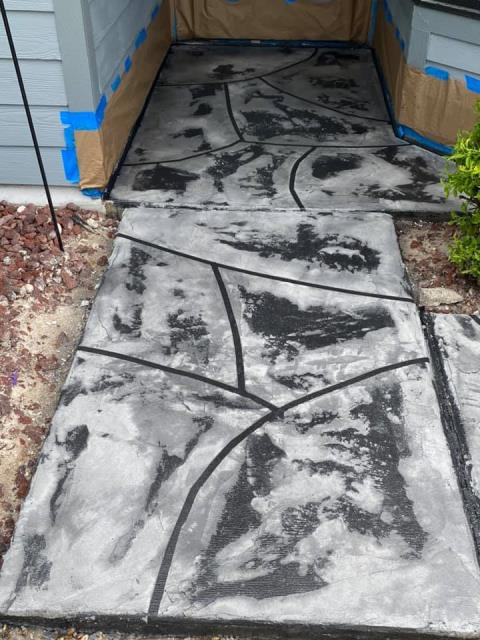 Gainesville, FL - All I can say is WOW!!! I never expected my walkway to be this beautiful! Gulfcoast Artistic Concrete blew my expectations out of the water with this fantastic job!! I received a beautiful stone look that I wanted, without breaking the bank!! Paul is a professional, talented, polite gentleman who takes pride in his work and team! His price was beyond fair for the work he provided!!! I HIGHLY recommend Paul and his crew!!!!