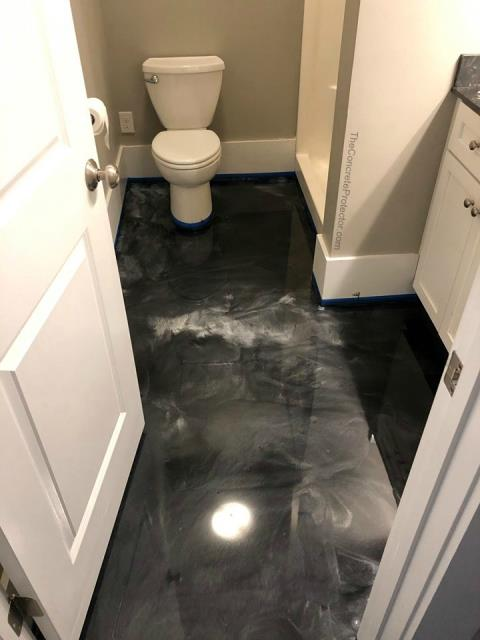 High Springs, FL - A stunning bathroom floor. Every part of it looks perfect, it couldn't be better! GulfCoast Artistic Concrete is a very professional business. They are a pleasure to work with, and do very professional looking work. With a guest bathroom like this, I can feel very proud welcoming people into my home and using my facilities!