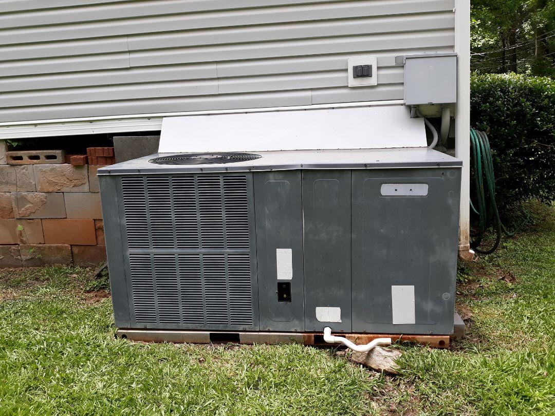 Salem, AL - Air repair. Goodman cooling unit. Package heat pump. Unit froze up. Add freon.
