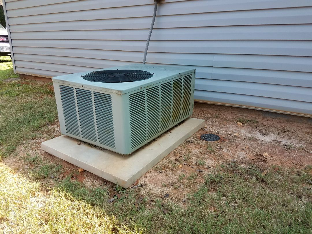 Smiths Station, AL - Service call air conditioner repair.  Ruud ac repair.  Clean drain line.