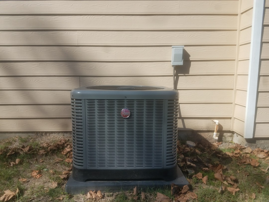 Phenix City, AL - Rheem air conditioner service call. Repair and service drain overflow line.