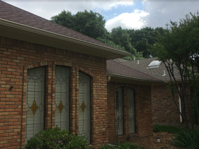 Addison, TX - Performing fascia, soffit, and frieze board replacement with premium quality James Hardie siding products on this beautiful home in Addison