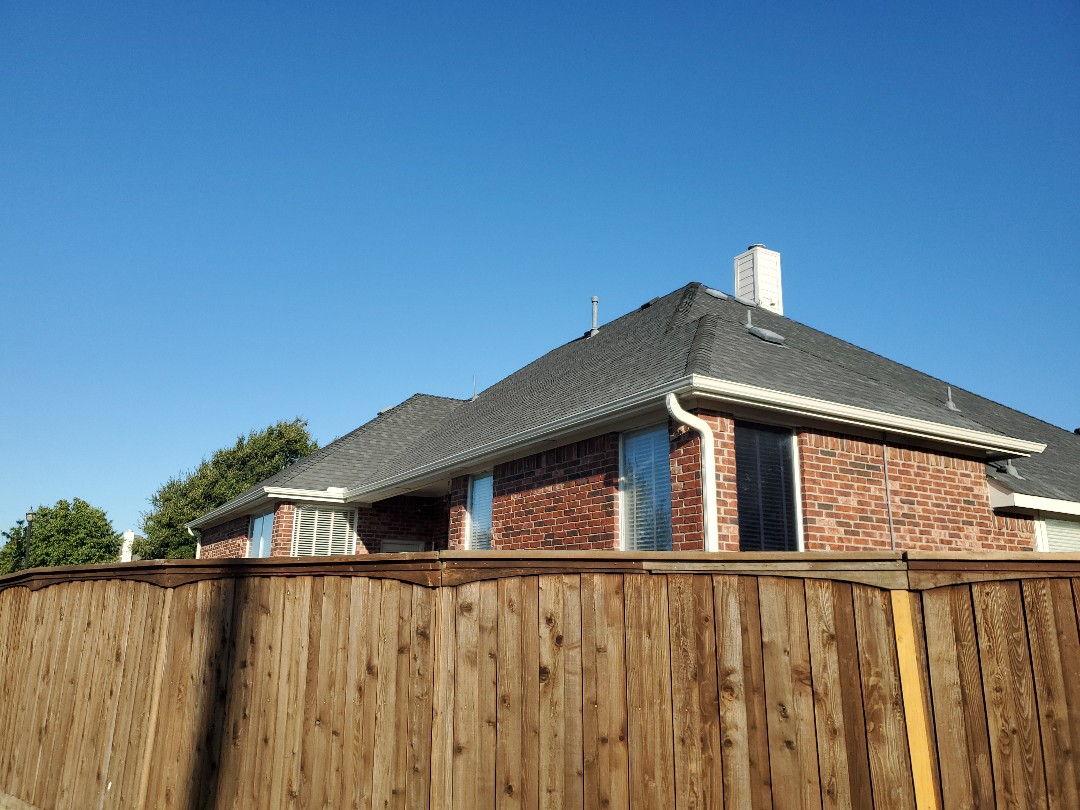 """Frisco, TX - Beauitful new 5"""" gutter system, with larger 3x4 downspouts for more efficient draining. Downspouts screwed into the brick for a more secure installation. Phillip's Gutter system is second to none."""
