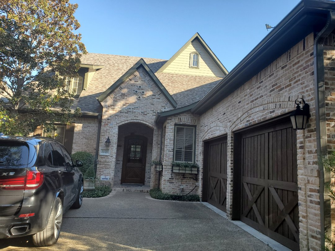 """Dallas, TX - Beautiful 6"""" gutters, made in the terratone, a dark grey seamless gutter to perfectly compliment the sherwin Williams resilience paint project."""
