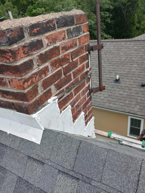 Pittsburgh, PA - Replaced flashing around this chimney to solve the problem of leaking water.