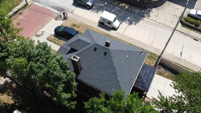 Pittsburgh, PA - Replaced old roof with new GAF lifetime shingled roof and Mule-Hide silicone roof system on back roof.