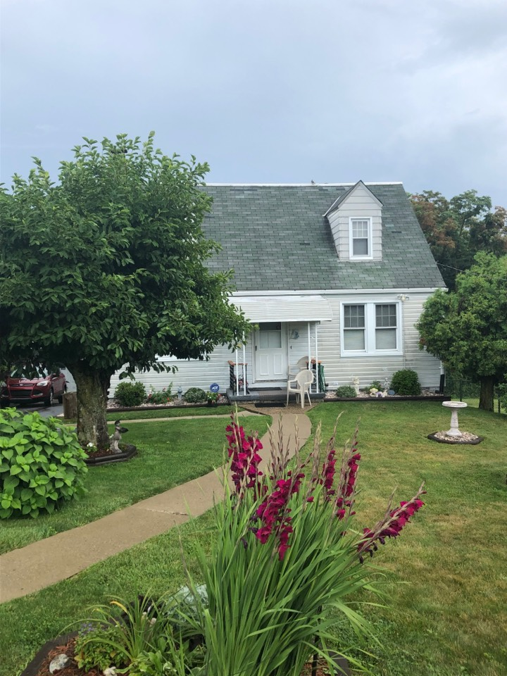 McKees Rocks, PA - This homeowner is interested in a new shingle roof for her house and garage