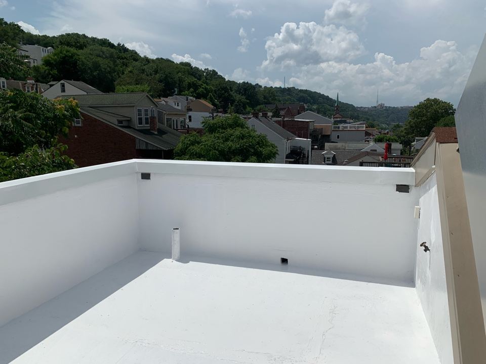 Tarentum, PA - Gaco silicone roofing applied to this deck roof.