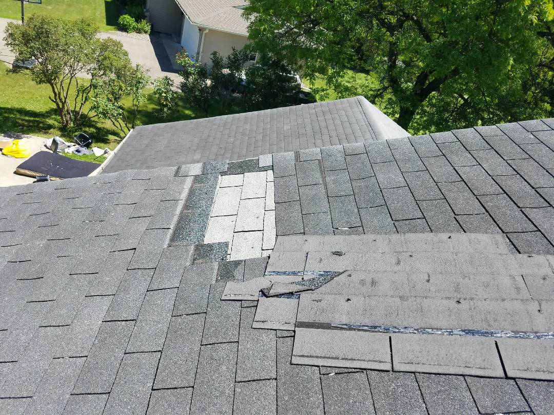 doing a roof storm damage inspection. this roof has 3 tab organic shingles that needs new roof. improper shingle install issues on this roof.