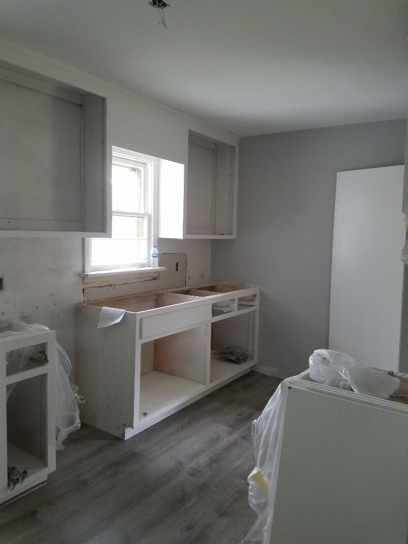 kitchen remodel in Brooklyn park, mn. white cabinets, quartz counter tops and vinyl flooring.