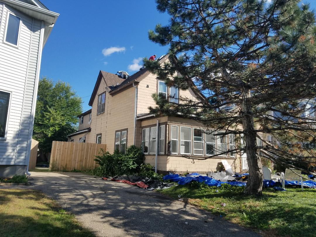 Minneapolis, MN - installing 30 year architectural IKO shingles. Roofing and roof redeck with OSB plywood.