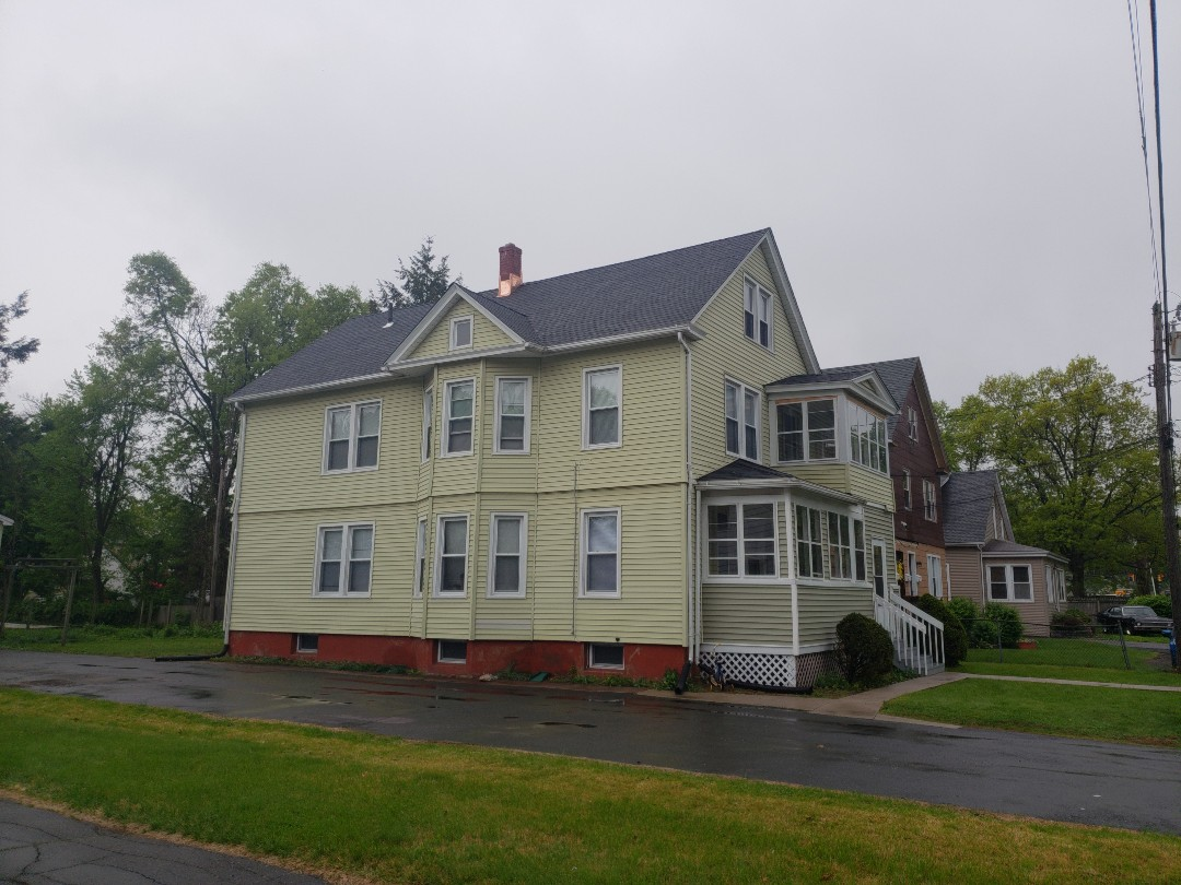 Manchester, CT - Harmony Home Improvement removes 3 layers of shingles installed plywood, GAF Timberline HD Charcoal Lifetime shingles, counterflashed the chimney with copper for another happy customer