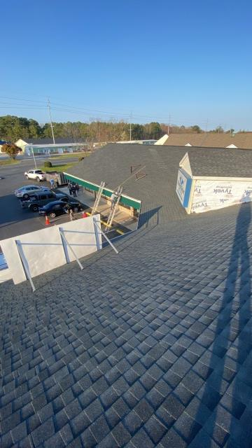 Ocean City, MD - Here's a commercial roof we just finished installing this beautiful new GAF shingle on in Ocean City, MD. We helped the owners through the entire insurance claim process to get this roof replacement. Our Siding experts are finishing up the last stages of this project.