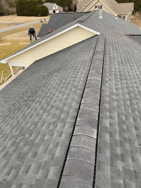 Seaford, DE - Look at that beautiful new GAF Charcoal roof replacement! This residential roof was a insurance claim, our experts helped the homeowner get a full roof replacement.