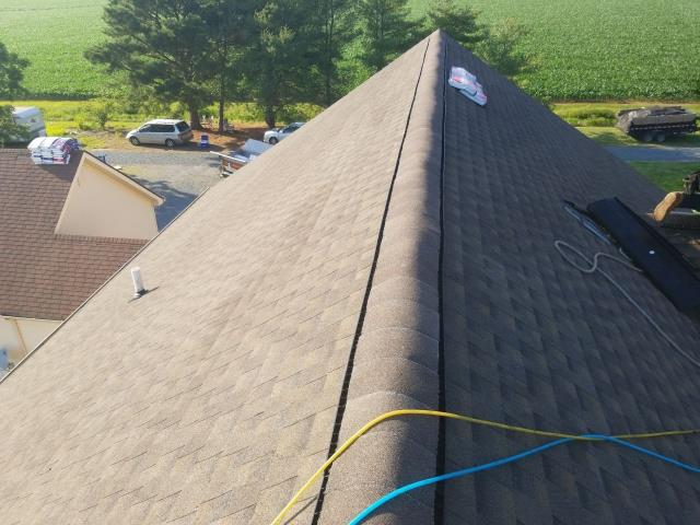 Marion Station, MD - We performed a free roof inspection and found wind damage all over the roof from the recent storms. We helped the homeowners file a claim and assisted them in the claims process which we got full replacement paid by their insurance company. We then installed a GAF Timberline HDZ Barkwood shingle on their roof! A 50 year non pro rated warranty on materials and labor.