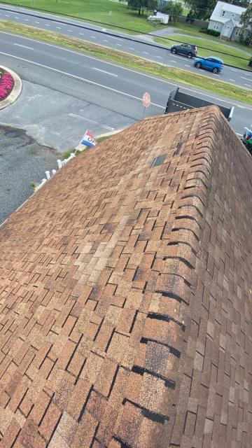 Georgetown, DE - Here we are preforming a free roof inspection for a customer who had some storm damage to his roof. We found missing shingles and creasing as a result of wind damage.