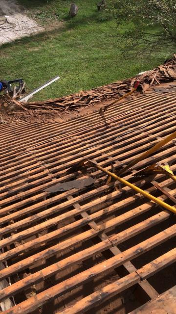 Harbeson, DE - Doing a cedar shake tear off with multiple layers of shingles.  We will be installing all new plywood and putting a new GAF Timberline HDZ roof.  This was a full roof replacement covered by insurance from storm damage.