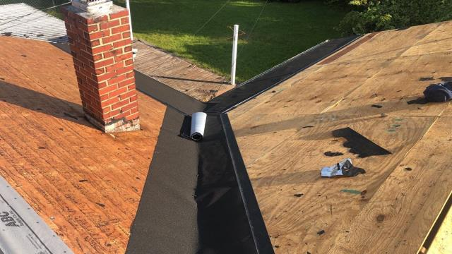 Seaford, DE - Working on a full roof replacement.  This is a residential roof where we are installing a new GAF roof.  We are the preferred roofing company in the area.