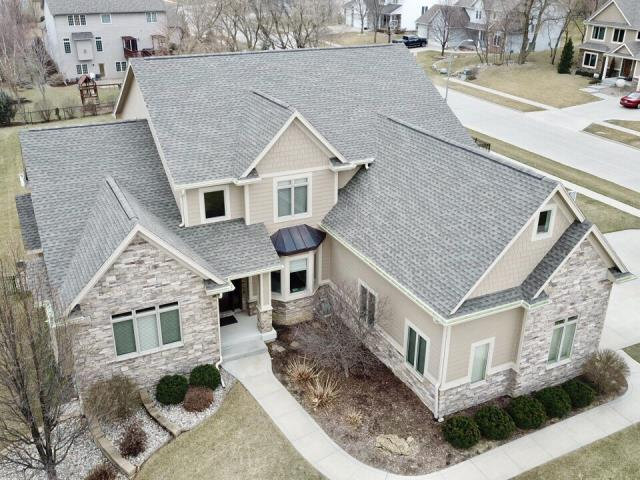 Johnston, IA - We replaced this roof after a hail storm came through Johnston last fall. We installed a GAF Timberline HD shingle in a Weathered Wood color!