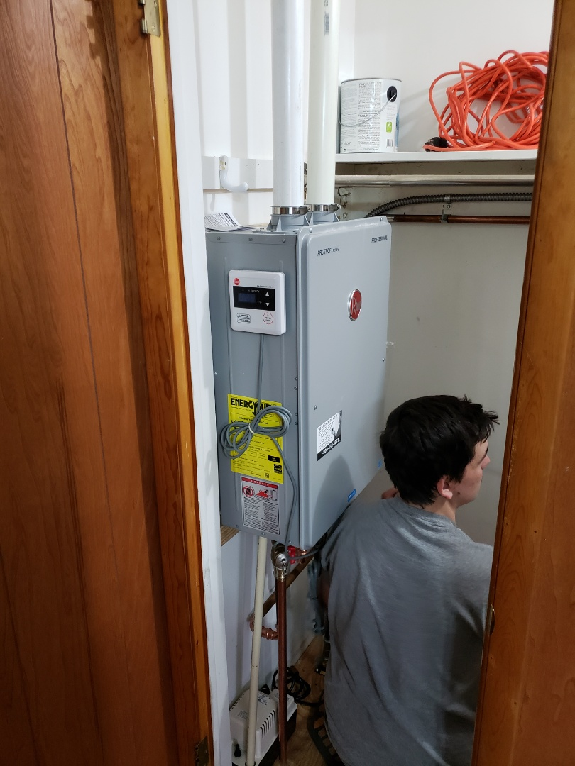 Fort Wayne, IN - Installing a Rheem tankless water heater in a laundry closet, old 40 gallon water heater used to be in the garage. Gaining a little more space in the garage,
