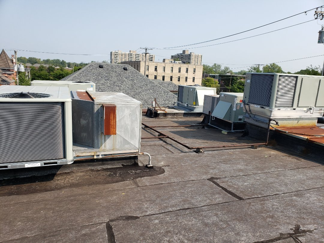 Fort Wayne, IN - Replacing five worn out packaging units on rooftop with brand new trane equipment all with fresh air hoods and new trane thermostats, very happy customer
