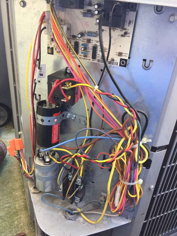 New Braunfels, TX - Home air conditioning repair on a carrier air conditioning unit, condenser compressor and capacitor.