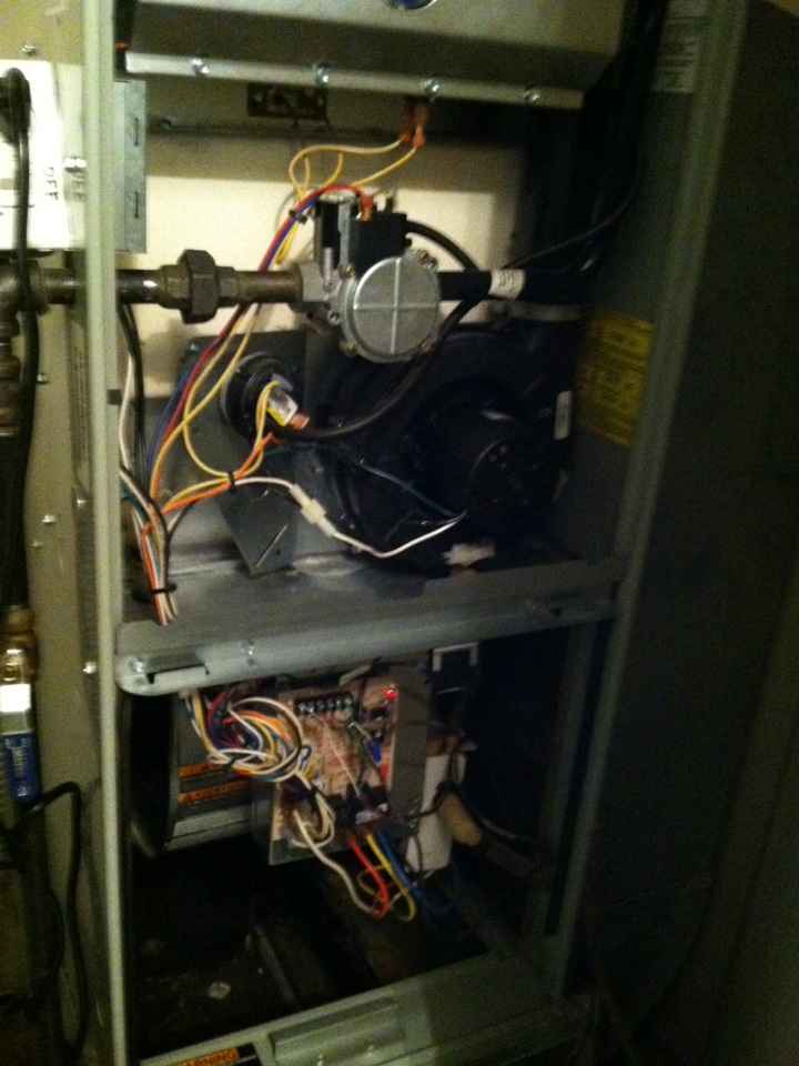 Hayden, ID - Performing heat maintenance on a Trane furnace