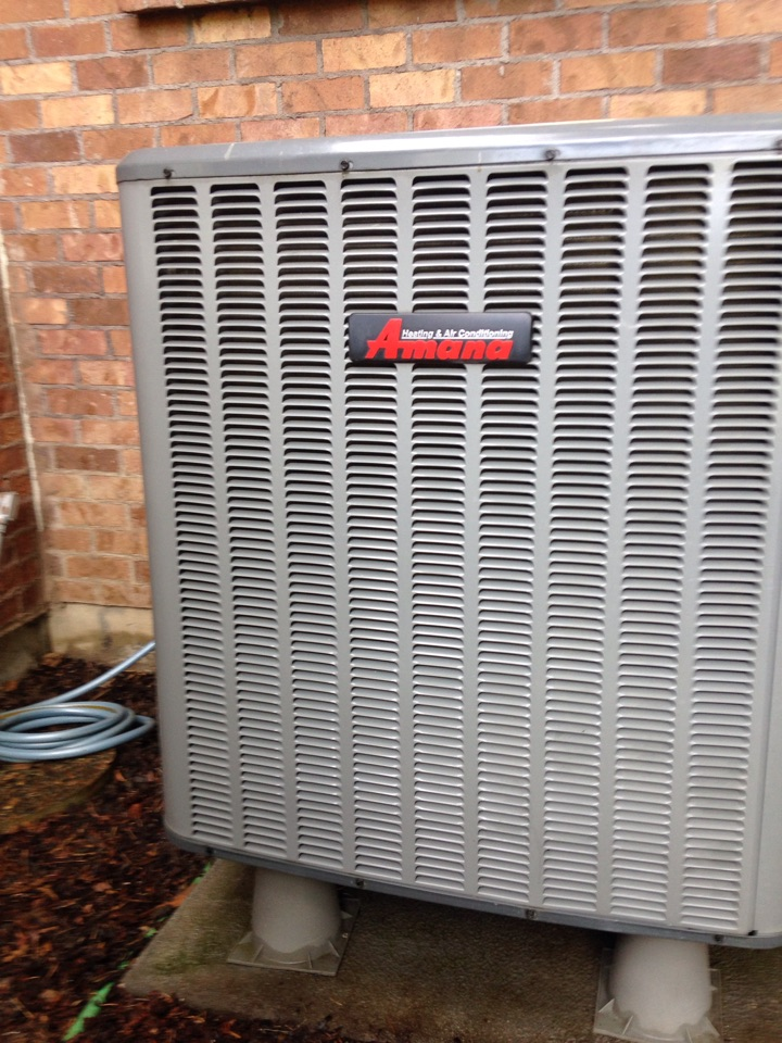 Mead, WA - Preventive maintenance on an Amana heat pump, air conditioner side in Mead, WA