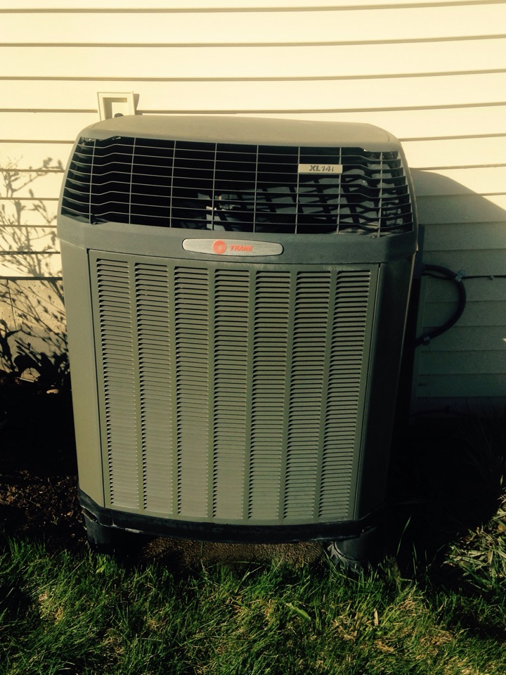 Valleyford, WA - Performing cooling maintenance on Trane heat pump