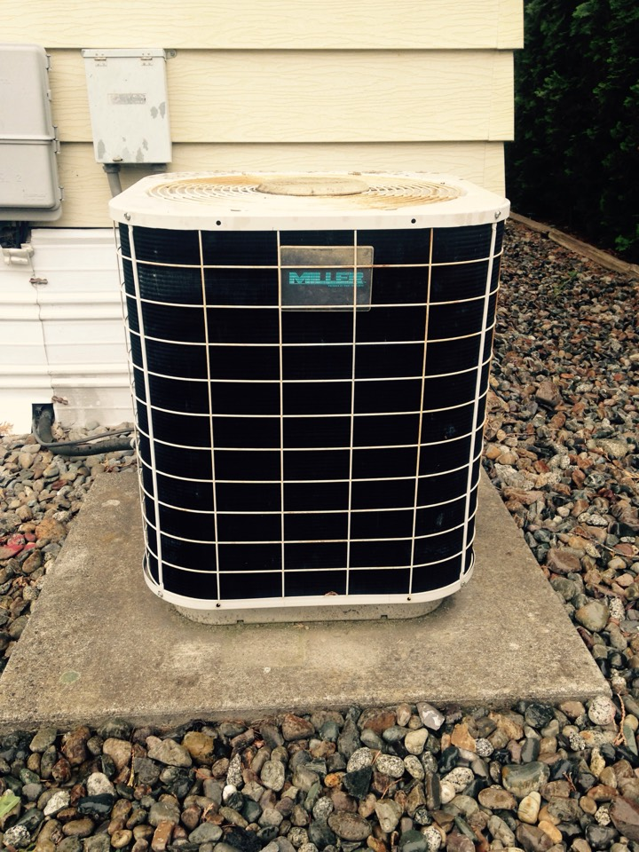 Spokane Valley, WA - Performing cooling maintenance on Miller air conditioner
